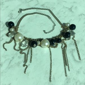 Fringe and faux pearl and faux crystal necklace